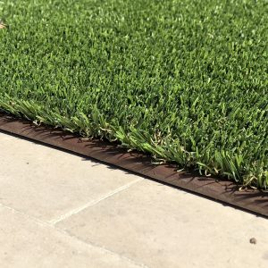 turf edging keeps pet turf in place on hard surfaces