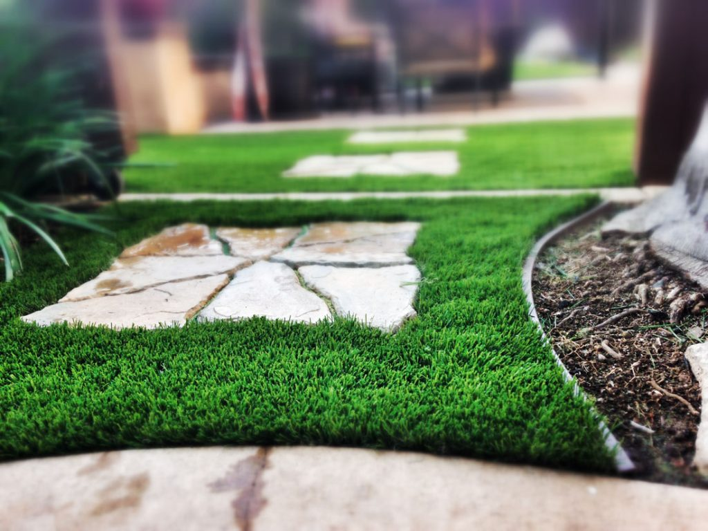 black synthetic grass edging and synthetic turf
