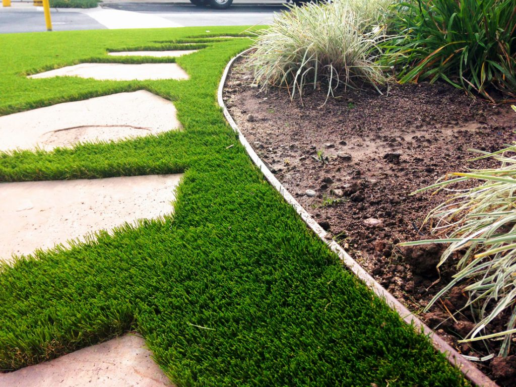 Wonder Edge and paving stones make a beautiful fake lawn perimeter