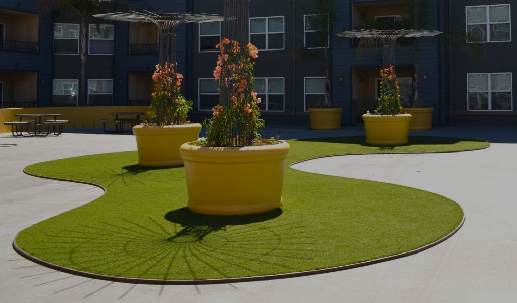 synthetic grass edging creates a line between turf and other surfaces